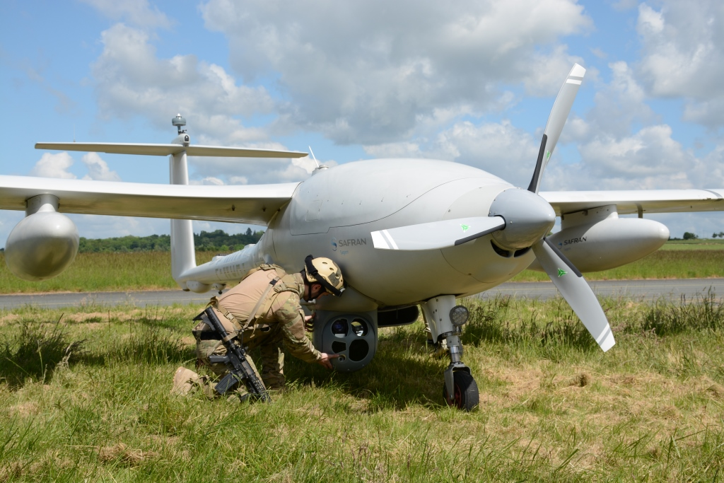 A Soldier Shows The Large Sensor Ball Of Sagems Patroller UAV Optionally Piloted Aircraft That Offers Much Greater Range And Payload Than Its
